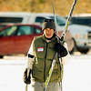 "Record-Eagle/Jan-Michael Stump<br /> John Holtz carries his skis to the Vasa Pathway Trailhead in Acme for Saturday's Winter Trails Day, sponsored by TART and the Vasa Ski Club. Club members taught lessons in both traditional and skate-skiing techniques. Holtz, who has been a traditional cross-country skier for 40 years, was there to learn the other method. ""If you do the traditional stuff, everyone is passing you with the skate-skiing stuff, so I thought I'd learn that today,"" he said."