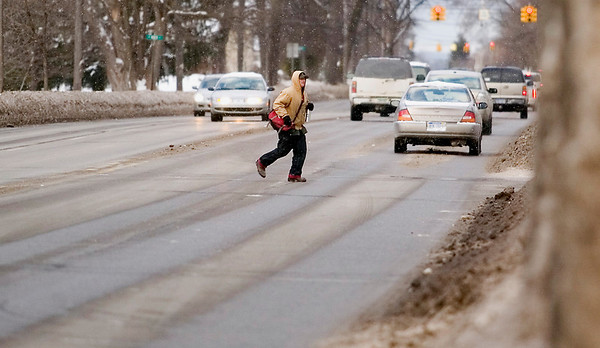 """Record-Eagle/Jan-Michael Stump<br /> """"It's kind of a mess right here,"""" said Dugan Dubois, who waited for several minutes to cross Division Street at 11th Street on Friday afternoon before walking down the street and crossing at 10th Street. """"I hope they do something about it."""" Traverse City commissioners will discuss how to move forward with their plans to improve or overhaul Division Street"""