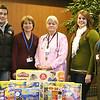 Record-Eagle/Lisa Perkins<br /> Children who spend hours receiving treatment at Munson Medical Center's Outpatient Infusion Clinic will have some new toys and games to help pass the time, thanks to a donation from Michigan Blood's 3D Campaign. Clinic manager Rebecca Asper, RN, OCN (middle) accepts the gifts from (left to right) donor Eric Warnaar, Sandra Warnaar, operations manager for Michigan Blood, donor Mariah Sika and Holly Sika, lead recruiter for Michigan Blood in northwest Michigan.