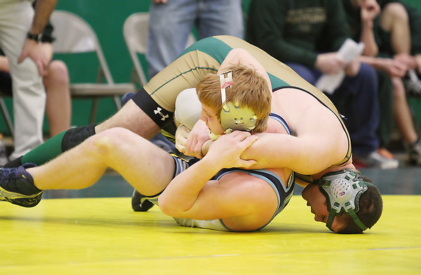 Record-Eagle/Keith King<br /> Traverse City West's Trevor Willnow, right, competes against Petoskey's Pat Antonides in the 189 pound weight class at Traverse City West High School. Willnow won the match.
