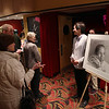 Record-Eagle/Keith King<br /> Traverse City Central High School exchange student, Kwan Chow, of Hong Kong, stands next to his drawing of Martin Luther King Jr. on Monday at the State Theatre.