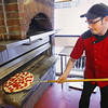 Record-Eagle/Keith King<br /> Loren Ferrer, chef at Pangea's Pizza, rotates a pepperoni and cheese pizza with a pizza peel in downtown Traverse City. Pangea's Pizza offers a gluten-free pizza crust.