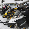Record-Eagle/Keith King<br /> Carson Bellman, of Bremen, Ind., right, sits on a snowmobile as fellow snowmobilers from Indiana prepare to depart for their ride Friday from the Mancelona Motel.