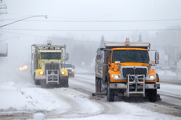 Record-Eagle/Jan-Michael Stump<br /> Plows clear Woodmere Avenue in Traverse City on Tuesday afternoon.