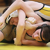 Record-Eagle/Keith King<br /> Traverse City Central's Cam Benak, top, and Traverse City West's Zach Provost compete Wednesday at Traverse City West High School. Benak won the match.