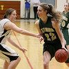 Record-Eagle/Keith King<br /> Traverse City West's Ressa Borkovich dribbles the ball as Traverse City Central's Logan Core defends at Traverse City Central High School.