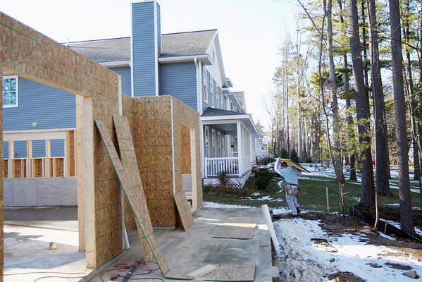 Record-Eagle/Keith King<br /> Construction takes place near recently built homes in the Fairway Hills subdivision, near the intersection of South Cass Street and 17th Street in Traverse City.
