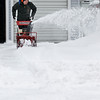 Record-Eagle/Jan-Michael Stump<br /> Zack Light clears the driveway of his Webster Street home after several inches of snow fell overnight in the region.