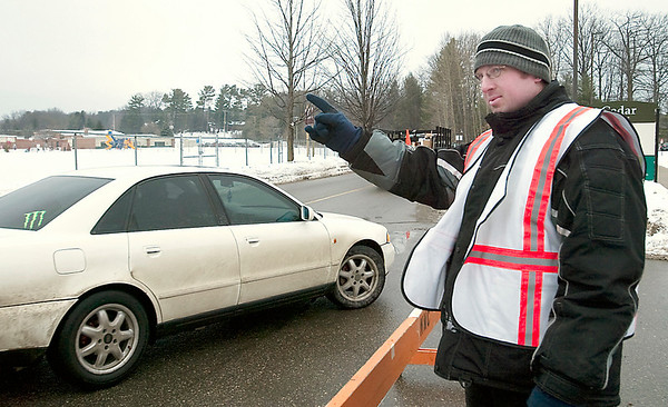 Record-Eagle/Douglas Tesner<br /> Chris Meredith, a temporary employee from Michigan Manpower, directs traffic into one of the parking lots at Northwestern Michigan College.