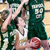 Record-Eagle/Douglas Tesner<br /> Traverse City Central's Aimee Marsh, center, is trapped by TC West defenders Gaby Muller, left, and Loren Wagner.