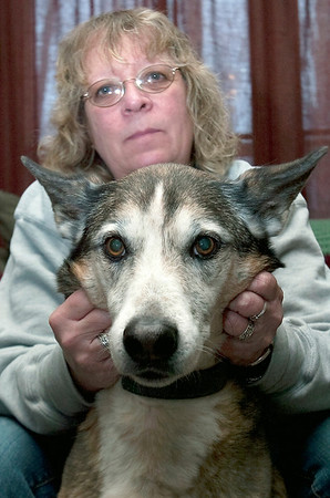 Record-Eagle/Douglas Tesner<br /> Joan Brewer with her dog, Annie.