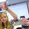 Record-Eagle/Jan-Michael Stump<br /> Dani Brzezinski, left, and Savannah Foster work on a tower made with marshmallows, spaghetti and toothpicks with Emily Ellison and Jane Hisenkamp (not pictured) during a program by two students from the Massachusetts Institute of Technology, who visited Traverse City West Senior High School Wednesday to encourage young women to explore futures in engineering.