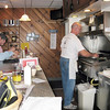 Record-Eagle/Jodee Taylor<br /> Owner Jim Rowland works the grill during lunch at Willie's Rear, now open after an 11-year hiatus.
