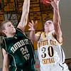 Record-Eagle/Douglas Tesner<br /> Traverse City Central's Dylan Roe (30) drives to the hoop against the defense of TC West's Evan Schultz (24). The Trojans won 70-60 in the first of two meetings.
