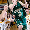 Record-Eagle/Douglas Tesner<br /> Traverse City West's Aaron Olsen (14) goes to the hoop against Central's Mike Heim (12).