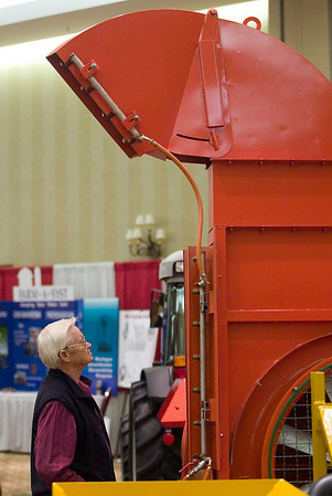Record-Eagle/Jan-Michael Stump<br /> Dick Wagner of East Bay checks out an orchard sprayer at the 2010 Orchard & Vineyard Show Tuesday at the Grand Traverse Resort & Spa in Acme.