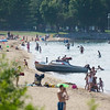 Record-Eagle file photo/Jan-Michael Stump<br /> Clinch Park Beach attracts both swimmers and boaters. A court ruling this week said the city can expand no-boat swimming areas on Grand Traverse Bay.