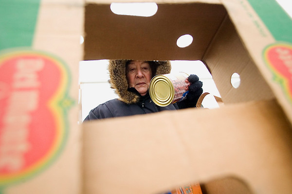 Record-Eagle/Jan-Michael Stump<br /> Volunteer Judy Pinger, of Bellaire, sorts donated food items outside the Garfield Plaza shopping center on Garfield Avenue on Tuesday afternoon for the Father Fred Foundation's 16th annual Frostbite Food Drive. Volunteers are accepting donated food items and cash from 7 a.m. to 6 p.m. on weekdays, 8 a.m. to 6 p.m. weekends, for the foundation's food pantry, which helps feed more than 3,000 families in Northern Michigan. The drive ends Jan. 24.