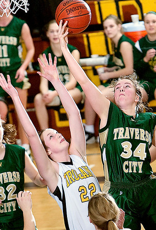 Record-Eagle/Douglas Tesner<br /> C West's Emily Ellison (34) reaches for a rebound over Central's Molly Walker.