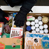 Record-Eagle/Jan-Michael Stump<br /> Volunteer Gordon Pinger, of Bellaire, sorts donated food items outside the Garfield Plaza shopping center on Garfield Avenue on Tuesday afternoon for the Father Fred Foundation's 16th annual Frostbite Food Drive. Volunteers are accepting donated food items and cash from 7 a.m. to 6 p.m. on weekdays, 8 a.m. to 6 p.m. weekends, for the foundation's food pantry, which helps feed more than 3,000 families in Northern Michigan. The drive ends Jan. 24.