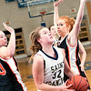Record-Eagle/Douglas Tesner<br /> St. Francis freshman Liza Erickson gets between two Harbor Springs defenders for a shot in Tuesday's game, won by the Gladiators.