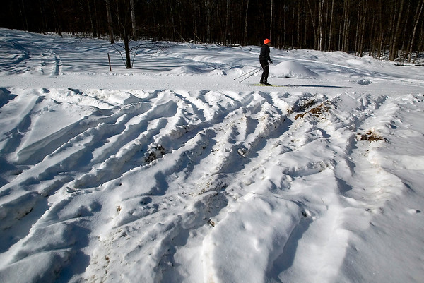 Record-Eagle/Jan-Michael Stump<br /> David Bartel skis down a repaired stretch of the Vasa Trail where someone drove a vehicle and damaged a number of trail signs late Tuesday or early Wednesday morning.