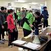 Record-Eagle/Douglas Tesner<br /> Runners line up to receive their numbers before taking part in the annual Frozen Foot Race sponsored by Traverse City Track Club and Running Fit.