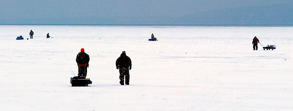 Record-Eagle/Douglas Tesner<br /> Ice fishermen move out onto partly frozen Crystal Lake. According to one fisherman, they were searching for perch.