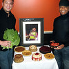 Record-Eagle/Marta Hepler-Drahos<br /> Matt Hunter, left, and Ralph Humes with an array of the foods they're planning to serve at The Soulhole, expected to open in March.