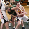 Record-Eagle/Douglas Tesner<br /> Traverse City West's Mallory Litwiller, left, tries to steal the ball from Traverse City Central's Katie Knudsen during Friday night's game at Central. West won 50-40.
