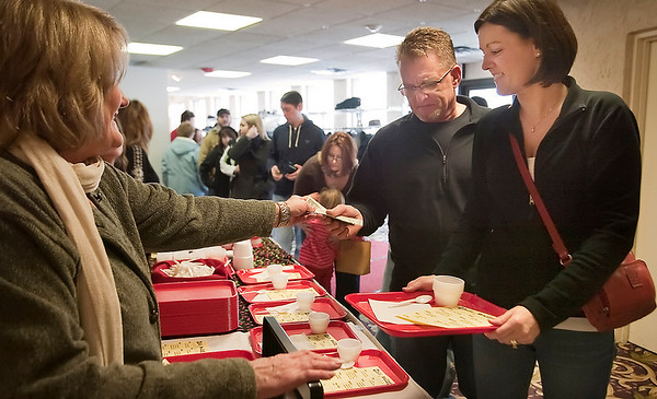Record-Eagle/Douglas Tesner<br /> Renee Stocker of Marysville leads the way into the Downtown Traverse City Chili Cook-off serving line Saturday.