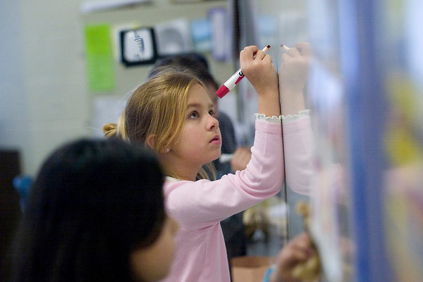 Record-Eagle/Jan-Michael Stump<br /> Suttons Bay Elementary School student Abigail Jean, 8, works on a math problem while spending recess in Deborah Lynch's classroom Wednesday afternoon. A community forum will be held Thursday to discuss the budget and seeks input from parents and citizens.
