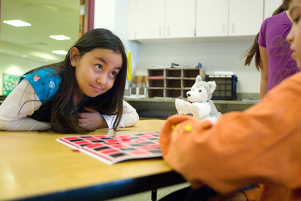 Record-Eagle/Jan-Michael Stump<br /> Suttons Bay Elementary School student Tyra John, 8, looks at Cameron Kitchen  while he makes his move in a game of checkers in Deborah Lynch's classroom during recess<br /> Wednesday afternoon. A community forum will be held Thursday to discuss the budget and seeks input from parents and citizens.