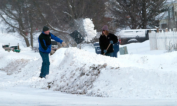 "Record-Eagle/Douglas Tesner<br /> Eric Mulvaine and his wife Erica clean up their driveway on Rasho Road a dumping of lake effect snow on the region. ""I just can't wait till I retire and move,"" Eric said with a smile."