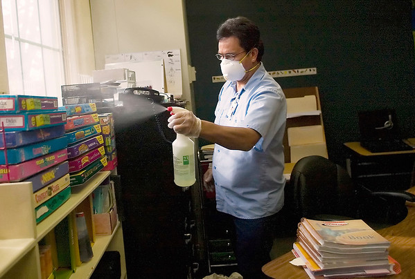 Record-Eagle/Jan-Michael Stump<br /> Alberto Dimas and other custodians sprayed down Central Grade School with hospital-grade disinfectant to kill the H1N1 flu virus.