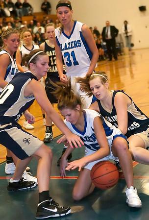 Record-Eagle/Douglas Tesner<br /> Kalkaska foward Sophia Menistrina battles with the St. Francis defense for a rebound.