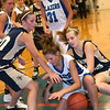 Record-Eagle/Douglas Tesner<br /> Kalkaska foward Sophia Menistrina battles with the St. Francis defense for a rebound.