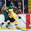 Record-Eagle/Jan-Michael Stump<br /> Traverse City West's Tyler Thirlby (14) and Traverse City Central's Lucas Little (10) collide along the boards.