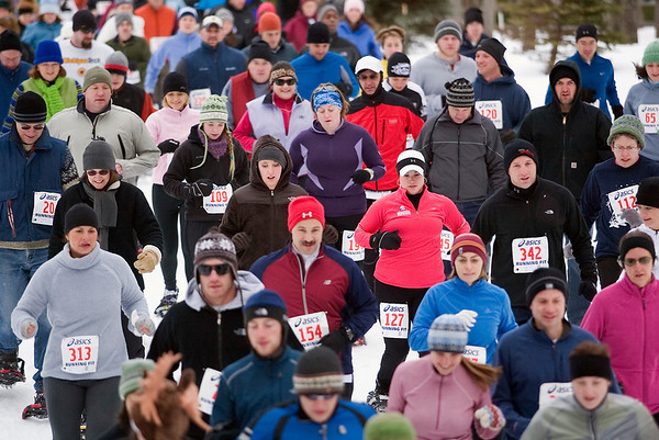 Record-Eagle/Jan-Michael Stump<br /> Racers start the Bigfoot 5k and 10k Snowshoe Race Saturday at Timber Ridge. This year's event had more than 360 entries -- a record -- and about 100 more than last year's race.