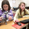 Record-Eagle/Douglas Tesner<br /> Kyra Tosiello, 13, and Rylee Price, 13, program their robot. Traverse City Christian School students are in the middle of J-Term, a two-week break from traditional academic classes in between semesters. Instead, the students take extracurricular classes, including service work, forensic science, robotics and cake decorating.