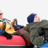 Record-Eagle/Jan-Michael Stump<br /> Marci Wolvin, left, and Mike Butler, both of Port Huron, go tubing at Mt. Holiday on Saturday afternoon. The group came to Traverse City after a lack of snow in Lewiston cancelled their snowmobiling trip.