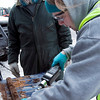 Record-Eagle/Douglas Tesner<br /> Douglas Gruizenga, left, watches as Amy Rivest, a geologist with the Michigan Department of Natural Resources and Environment, checks for potential gasoline pollution on his property.