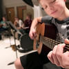Record-Eagle/Douglas Tesner<br /> Dennis Alekseyenko, 14, takes a guitar lesson.  Traverse City Christian School students are in the middle of J-Term, a two-week break from traditional academic classes in between semesters.