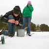 Record-Eagle/Jan-Michael Stump<br /> Mark Send, 15, left, of East Bay, baits his hook during an ice fishing trip on Arbutus Lake with his cousin Olivia Gifford, 11, of Troy, Mo., on Saturday afternoon.