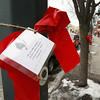 Record-Eagle/Keith King<br /> Red ribbons are tied Wednesday in downtown Traverse City to raise awareness about heart disease being a leading killer of women. National Wear Red Day is Friday.