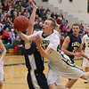 Record-Eagle/Keith King<br /> Traverse City West's Graeme Placek drives for a basket against Cadillac on Tuesday.
