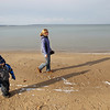Record-Eagle/Keith King<br /> Nanny Heidi Wood, of Traverse City, and her charge, Owen Smith, 4, of Traverse City, take advantage of mild temperatures as they take a walk along West Grand Traverse Bay in Traverse City.