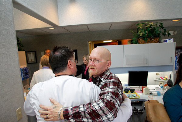 Record-Eagle/Jan-Michael Stump<br /> Dr. Phillip Yancho, left, gets a hug from Gary Mateer after fitting him for dentures.