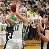 Record-Eagle/Keith King<br /> Traverse City West's Donny Cizek shoots the ball against Cadillac at Traverse City West High School.