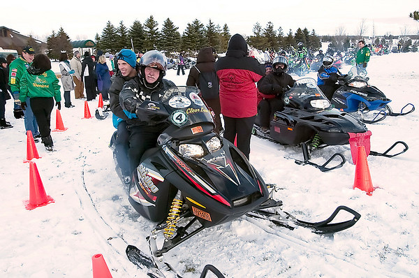 Record-Eagle/Douglas Tesner<br /> Wertz Warriors line up to take Olympians for snowmobile rides during the Special Olympics Michigan State Winter Games at Grand Traverse Resort & Spa. Special Olympics officials also paid tribute to Mark Fidrych.